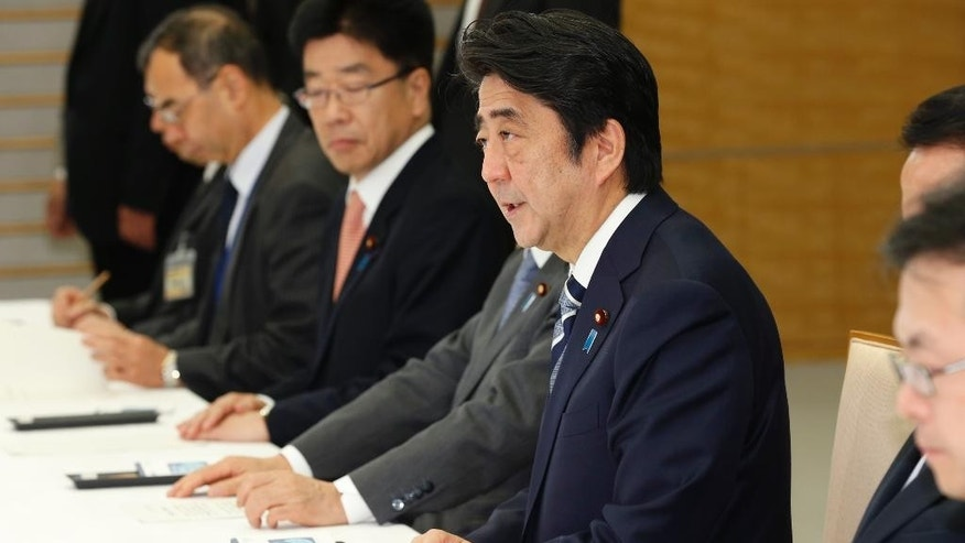 Japan's Prime Minister Shinzo Abe, second right, speaks during a hurriedly held ministerial meeting on Japanese hostage Kenji Goto taken by the Islamic State group, at the prime minister's official residence in Tokyo Thursday, Jan. 29, 2015. The extremist group released a message late Wednesday purportedly extending the deadline for Jordan's release of an Iraqi would-be hotel bomber linked to al-Qaida. The message, read by a voice claiming to be Goto, was released online after Jordan offered a precedent-setting prisoner swap to the Islamic State group, desperately seeking to save a Jordanian air force pilot the militants purportedly threatened to kill, along with Goto. Japanese government spokesman said on Thursday the government was analyzing the latest message and Japan was doing its utmost for the release of Goto, working with nations in the region, including Turkey, Jordan and Israel. (AP Photo/Shizuo Kambayashi, Pool)