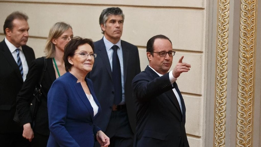 Polish Prime Minister Ewa Kopacz, left, and French President Francois Hollande, right, arrive for a group photo at the Elysee Palace in Paris, Friday, Jan. 30, 2015. (AP Photo/Michel Euler)