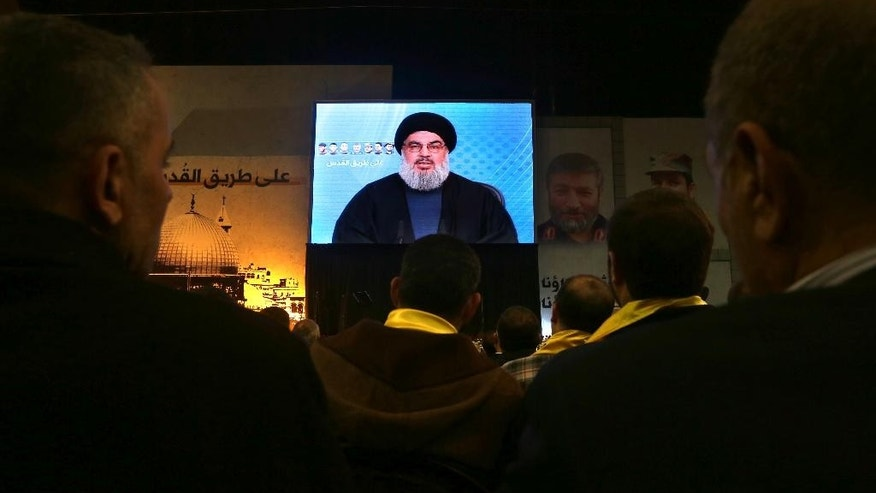 Hezbollah leader Sheikh Hassan Nasrallah, speaks via video link to his supporters during a ceremony marking the death of six Hezbollah fighters and an Iranian general who were killed in an Israeli airstrike in Syria's Golan Heights last week, in the southern suburb of Beirut, Lebanon, Friday, Jan. 30, 2015. Nasrallah said his group will no longer abide by any rules of engagements suggesting he has the right to retaliate to any future Israeli attack at the place and time Hezbollah choses. (AP Photo/Bilal Hussein)