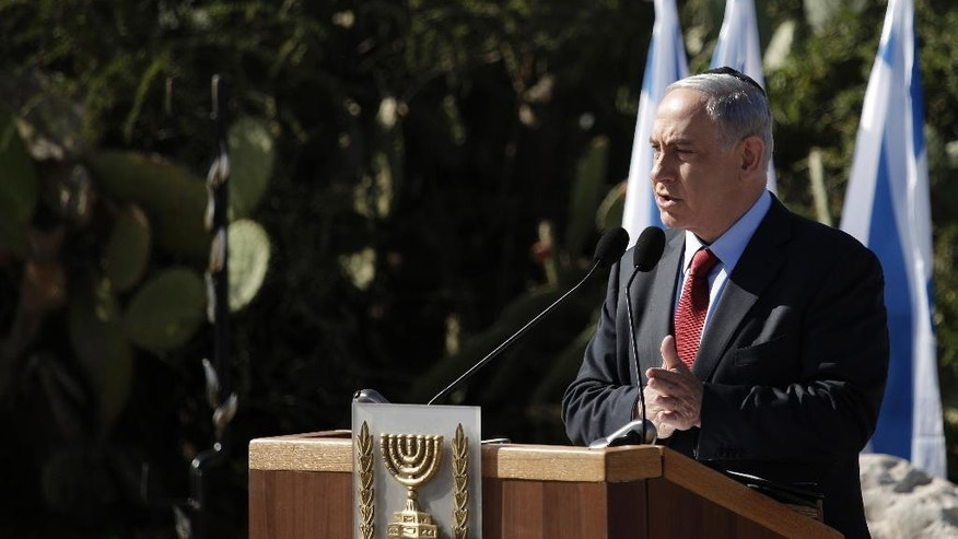 Israeli Prime Minister Benjamin Netanyahu speaks during the memorial ceremony of former Israeli Prime Minister Ariel Sharon, on the 1st anniversary of his death at his grave site, in Havat Shikmim southern Israel, Thursday, Jan. 29, 2015.(AP Photo/Tsafrir Abayov)