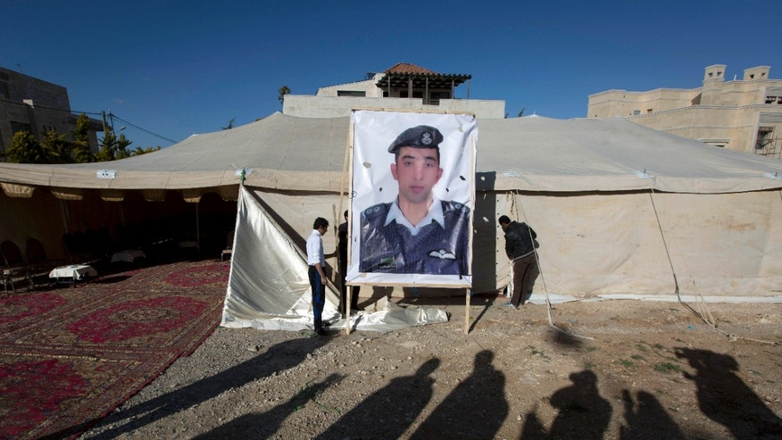 Jan. 30, 2015 - A picture of Jordanian pilot, Lt. Muath al-Kaseasbeh-- held by ISIS militants-- near a tent prepared for receiving supporters, in Amman, Jordan. The fates of a Japanese journalist and Jordanian military pilot were unknown Friday, a day after the latest purported deadline for a possible prisoner swap passed.