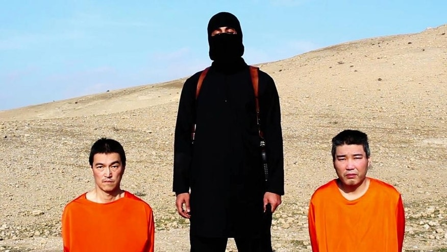 FILE - This file image taken from an online video purportedly released by the Islamic State group's al-Furqan media arm on Tuesday, Jan. 20, 2015, but lacks their logo, purports to show the group threatening to kill two Japanese hostages that the militants identify as Kenji Goto, left, and Haruna Yukawa, right, unless a $200 million ransom is paid within 72 hours. Far from the high-tech, slickly edited videos involving beheaded Western hostages through which the group impressed supporters and terrorized opponents, recent messages purporting to be from Japanese hostage Kenji Goto have been through digitized, audio dispatches featuring either still photos or text. Experts who examined this video said it was more likely filmed in an indoor studio with a false backdrop. (AP Photo, File)