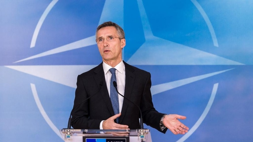 NATO Secretary General Jens Stoltenberg speaks during a media conference at NATO headquarters in Brussels on Monday, Jan. 26, 2015. Ambassadors met on Monday for an extraordinary meeting of the NATO-Ukraine Commission and released a statement condemning the sharp escalation of violence along the ceasefire line in eastern Ukraine. (AP Photo/Geert Vanden Wijngaert)