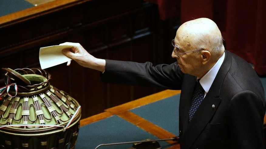Former Italian President Giorgio Napolitano casts his vote at the lower chamber during a voting session for the election of the new Italian President in Rome, Friday, Jan. 30, 2015. Lawmakers failed to elect a new Italian president Thursday in balloting that tests Premier Matteo Renzi's ability to rally his fractured party behind a candidate that is also acceptable to opposition leader Silvio Berlusconi, whose support he has courted for the government's ambitious reform agenda. Even as the names on the hand-written ballots from the 1,009 electors were still being read aloud, it was clear that, as expected, no candidate had come remotely close to the two-thirds majority needed to elect a new head of state in the first three rounds. (AP Photo/Gregorio Borgia)