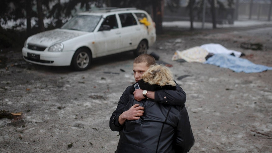 Jan. 30, 2015: A rebel comforts a wife of a killed civilian in shelling in Donetsk, eastern Ukraine.