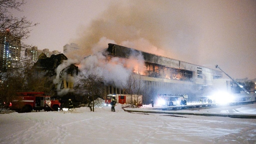 Firefighters put down the blaze at a library of the Russian Academy of Sciences in Moscow, Saturday, Jan. 31, 2015. A fire at one of Russia's largest libraries has been raging for more than 17 hours, to destroy thousands of rare documents. (AP Photo/Alexander Zemlianichenko Jr)