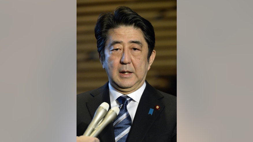 Japanese Prime Minister Shinzo Abe speaks to reporters at his official residence in Tokyo Sunday, Feb. 1, 2015 following the release of an online video purportedly from the Islamic State group that shows a militant beheading Japanese journalist Kenji Goto. (AP Photo/Kyodo News) JAPAN OUT, MANDATORY CREDIT