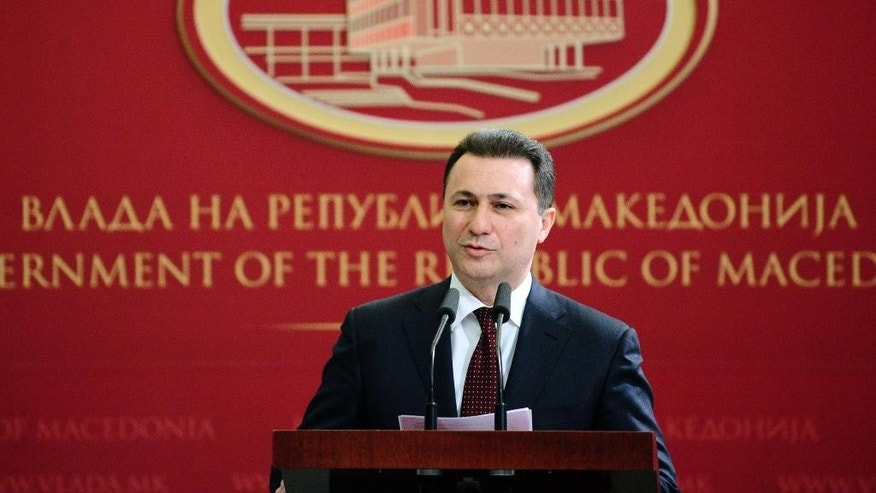 "Macedonian Prime Minister Nikola Gruevski speaks during a news conference at the government building in Skopje, Macedonia, on Saturday, Jan. 31, 2015. Prime Minister Gruevski has accused Saturday the leftist oppositional leader Zoran Zaev, of attempting to organize a coup by blackmailing him with ""recorded phone conversations that discredit country's leadership"" in order to agree on forming a technical government and early elections. The leader of the main leftist oppositional party Zoran Zaev was charged for ""violence against representatives of the highest state authorities"". He was questioned by the investigative judge, but was not arrested and according to local media, he was ordered to hand over his passport. (AP Photo/Boris Grdanoski)"