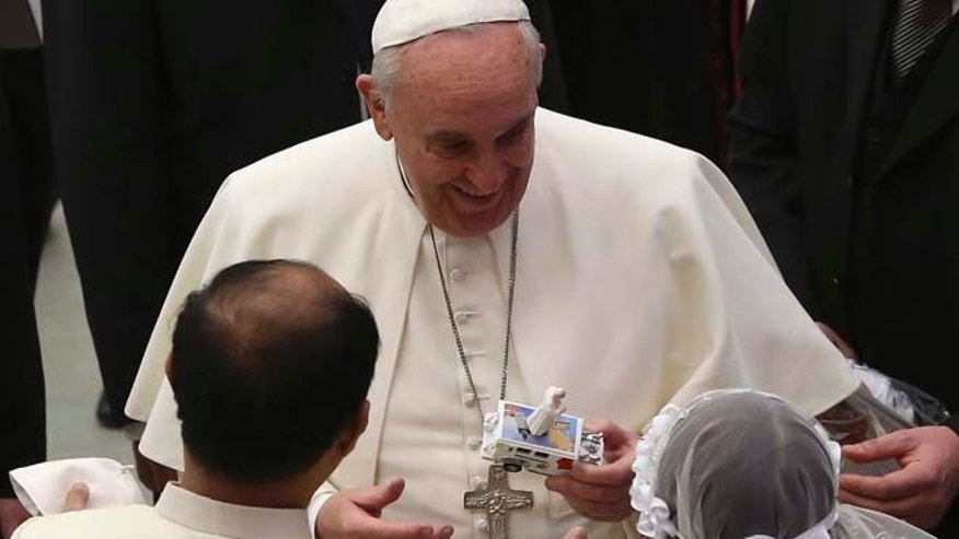 Jan. 28: Pope Francis receives a toy of himself as he leads his Wednesday general audience in Paul VI hall at the Vatican.
