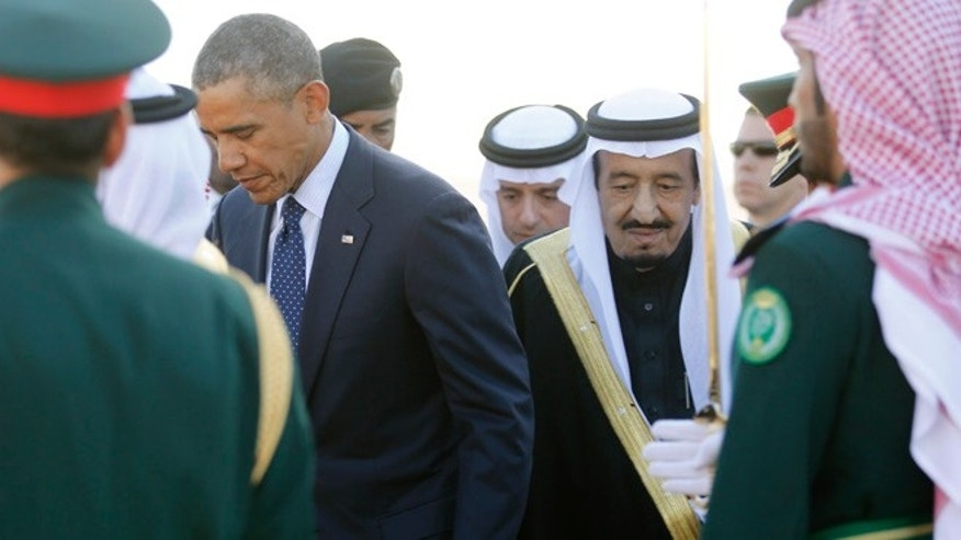 Jan 27: President Obama is greeted by Saudi Arabia's King Salman as he arrives at King Khalid International Airport in Riyadh.