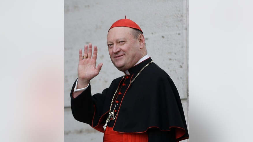In this March 4, 2013 file photo Italian Cardinal Gianfranco Ravasi waves to reporters as he arrives for a meeting, at the Vatican. A new Vatican initiative to actually listen to women hit a sour note before it even got off the ground when an Internet promotional video featuring a sexy blonde was so ridiculed that it was quickly taken down. But the initiative is going ahead, and an inaugural meeting this week will study women's issues in ways that are utterly new for the Holy See. The latest initiative comes courtesy of Cardinal Gianfranco Ravasi, an academic who quotes Nietzsche as easily as Amy Winehouse and has no fear of courting controversy as he raises the Vatican profile in sport, art and even atheist circles at the helm of the Vatican's culture ministry. (AP Photo/Andrew Medichini, file)