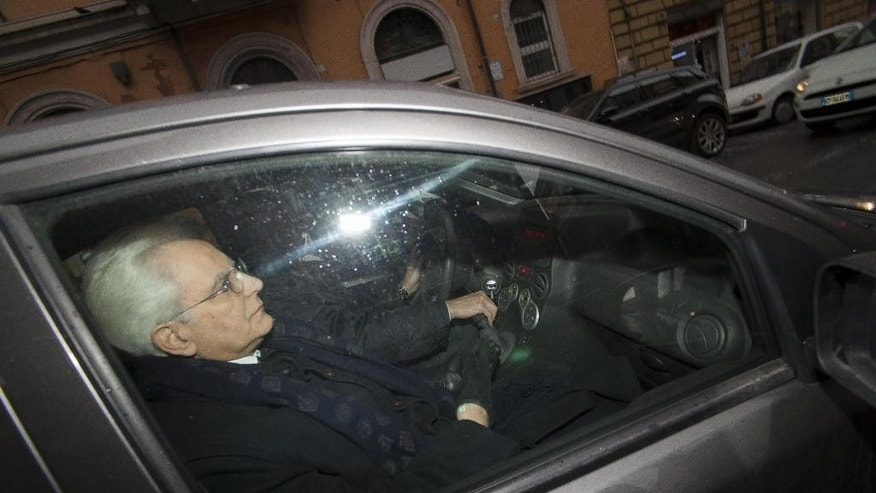 New Italian President Sergio Mattarella is seen inside a car in Rome, Jan. 31, 2015. Sergio Mattarella, constitutional court justice, is elected Italy's president by lawmakers. (AP Photo/Paolo Gargini, Ansa) ITALY OUT