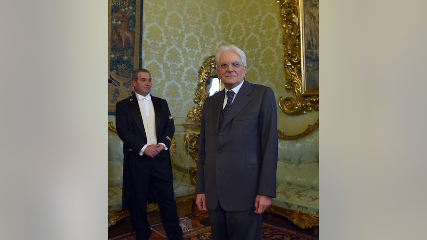 """New Italian President Sergio Mattarella poses for photographers at the Constitutional court building near the Quirinal Palace, the official residence of the President of the Italian Republic, in Rome, Jan. 31, 2015. Italian lawmakers elected Sergio Mattarella, a Constitutional Court justice widely considered to be above the political fray, as the nation's new president on the third day of voting Saturday. Mattarella's election as head of state was clinched when he amassed 505 votes — a simple majority. The 73-year-old former minister with center-left political roots went on to garner 665 votes from the 1,009 eligible electors. Known as a man of few words, Mattarella cemented that reputation with his first remarks to the nation. """"My thoughts go, above all, to the difficulties and hopes of our fellow citizens. That's enough, he said, referring to the grim economic situation. Italy is mired in recession and unemployment has hovered about 13 percent nationally. Young Italians are increasingly seeking work abroad. (AP Photo/Ettore Ferrari, Ansa) ITALY OUT"""