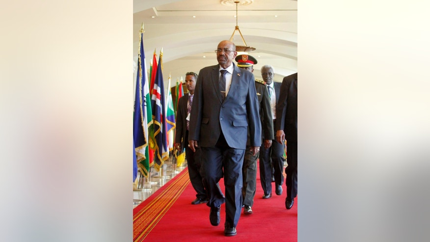 Sudan's President Omar al-Bashir arrives for the Intergovernmental Authority on Development (IGAD) summit, held on the eve of the heads of state meeting of the African Union summit, in Addis Ababa, Ethiopia Thursday, Jan. 29, 2015. The threat posed by Boko Haram, Nigeria's Islamic extremist rebels, will be a focus of U.N. Secretary-General Ban Ki-moon as he attends the African Union heads of state summit in Addis Ababa, Ethiopia, a spokesman said. (AP Photo/Elias Asmare)