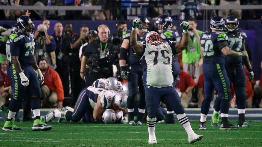 New England Patriots defensive tackle Vince Wilfork (75) celebrates after Malcolm Butler intercepted Seattle Seahawks quarterback Russell Wilson during the second half of NFL Super Bowl XLIX football game Sunday, Feb. 1, 2015, in Glendale, Ariz. The Patriots won 28-24. (AP Photo/Elise Amendola)