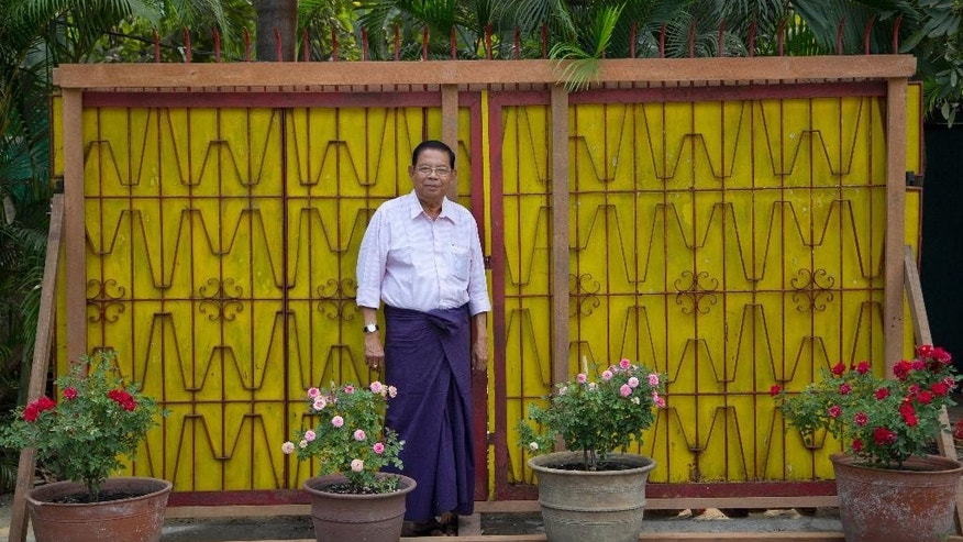 Soe Nyunt, the current owner of the iron gate that stood in front of the home of Myanmar's formerly imprisoned democracy icon, Aung San Suu Kyi, separating her from throngs of cheering supporters as she made speeches challenging the country's then-military rulers, poses for a picture in Yangon, Myanmar, Monday, Feb. 2, 2015. Soe Nyunt said he would auction the gate with a starting bid of $200,000.(AP Photo/Gemunu Amarasinghe)