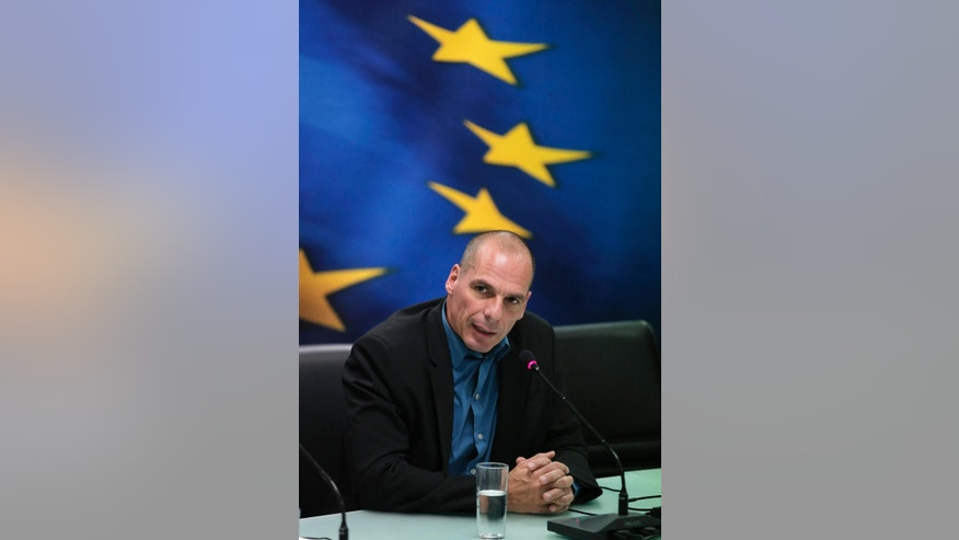 Greece's Finance Minister Yanis Varoufakis, answers a reporter's question during a joint news conference with Dutch Finance Minister and Eurogroup President Jeroen Dijsselbloem, following their meeting at the Finance Ministry in Athens, Friday, Jan. 30, 2015. Dijsselbloem who chairs eurozone finance meetings says there is no decision so far on what to do after Greece's current bailout program runs out at the end of next month. (AP Photo/Lefteris Pitarakis)
