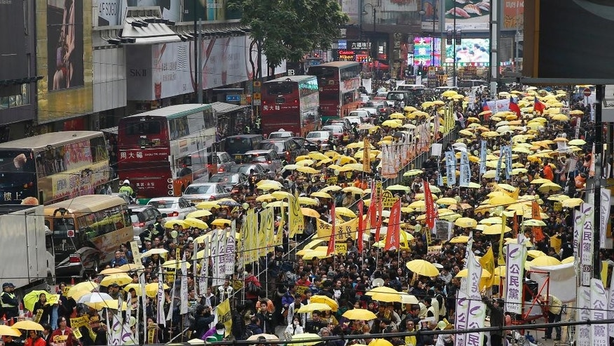 Feb. 1, 2015: Thousands of pro-democracy activists take part in a democracy march to Central, demanding for universal suffrage in Hong Kong. (AP)