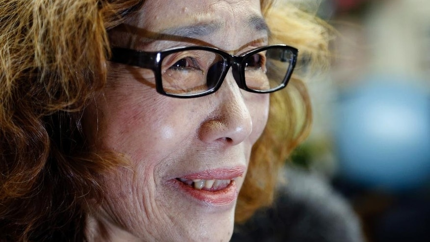 Junko Ishido, mother of Japanese journalist Kenji Goto, speaks during a press conference at her home in Tokyo, Sunday, Feb. 1, 2015 after the release of an online video that purported to show an Islamic State group militant beheading her son. Japan condemned with outrage and horror on Sunday the video posted on militant websites late Saturday Middle East time. (AP Photo/Shizuo Kambayashi)