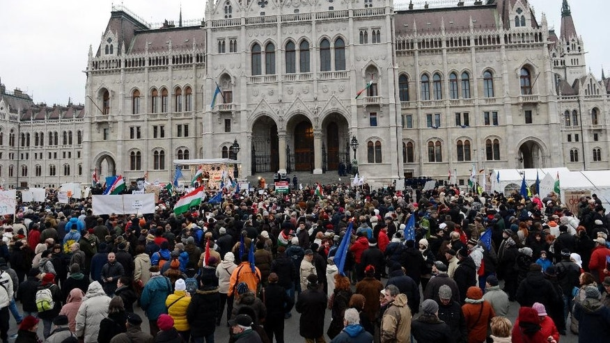 "Demonstrators gather   in front of the Hungarian Parliament building during an anti-goverment demonstration  in Budapest, Hungary, Sunday, Feb. 1, 2015.  The protesters demanded the ouster of Prime Minister Viktor Orban's government on the eve of a visit to Hungary by German Chancellor Angela Merkel. Organizer Balazs Gulyas said Sunday's rally attended by around 3,000 people was meant to show ""that the majority of the country does not support (Orban's) policies going closer to Vladimir Putin."" (AP Photo/MTI,Tamas Kovacs)"