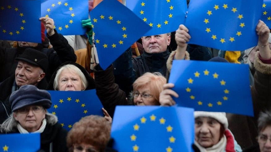 "Demonstrators hold EU flags aloft as they attend an anti-goverment demonstration  in front of the Hungarian Parliament building in Budapest, Hungary, Sunday, Feb. 1, 2015.   The protesters demanded the ouster of Prime Minister Viktor Orban's government on the eve of a visit to Hungary by German Chancellor Angela Merkel. Organizer Balazs Gulyas said Sunday's rally attended by around 3,000 people was meant to show ""that the majority of the country does not support (Orban's) policies going closer to Vladimir Putin.""(AP Photo/MTI,Tamas Kovacs)"