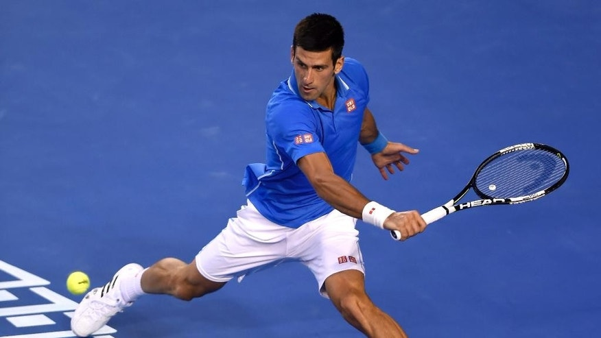 Novak Djokovic of Serbia plays a shot to Andy Murray of Britain during the men's singles final at the Australian Open tennis championship in Melbourne, Australia, Sunday, Feb. 1, 2015. (AP Photo/Andy Brownbill)