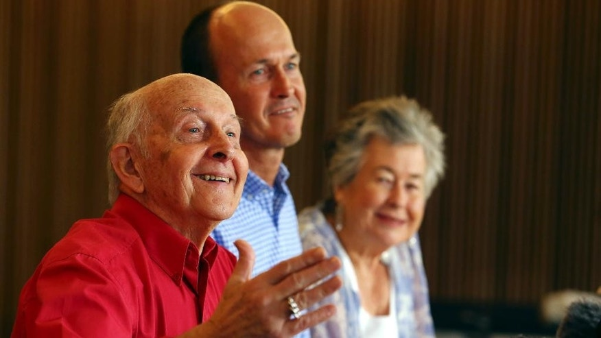 Juris, left, and Lois Greste, parents of Australian journalist Peter Greste, and his brother Andrew, center, speak to the media at a press conference in Brisbane, Australia, Monday, Feb. 2, 2015. Peter Greste, a reporter for Al-Jazeera English was released from an Egyptian prison and deported Sunday after more than a year behind bars. (AP Photo/Tertius Pickard)