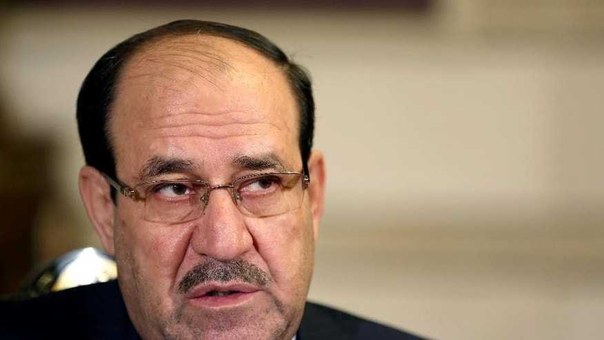 Iraq's Vice President and former Prime Minister Nouri al-Maliki, listens to a question during an interview with The Associated Press in Baghdad, Iraq, Monday, Feb. 2, 2015. Al-Maliki denies he is seeking a political comeback despite frequent appearances in local media and a recent high-profile visit to influential neighboring Iran. (AP Photo/Khalid Mohammed)