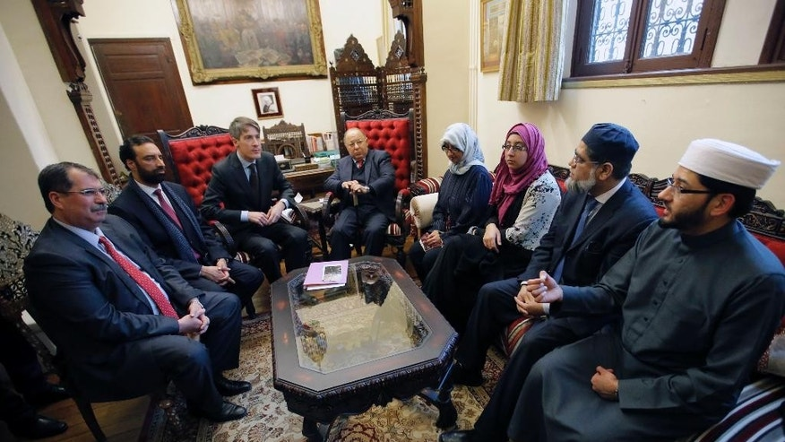 From left, Anouar Kbibech, president of Rassemblement of Muslims of France, (RMF), Sahukat Warraich, British Chief Editor at Imams Online and CEO at Faith Associates, Thomas Andrieu, a top aide to the French Interior Minister, Great Mosque of Paris rector Dalil Boubakeur, Khola Hasan, speaker and author from London, Naima Ali Khan, teacher at Birmingham's Quran Academy, Zaheer Shabir, Imam at Bristol Council of Mosques, listen to Qari Mohammed Asim MBE, Senior Imam At Leeds' Makkah Masjid during a meeting at the Grand Central Mosque in Paris, France, Monday, Feb. 2, 2015. British Imams travel to Paris to meet with Muslim and Jewish leaders to stand together in solidarity against extremism. (AP Photo/Francois Mori)