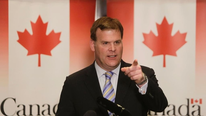FILE - In this Jan. 15, 2015, file photo, Canadian Foreign Minister John Baird talks during a news conference in Cairo, Egypt. Baird is resigning from the Cabinet. The official who is close to the minister said late Monday, Feb. 2, 2015, that Baird simply felt it was the right time to move on after a successful career in both the Ontario provincial legislature and federal parliament. The official spoke on condition of anonymity because he was not authorized to speak ahead of Tuesday's announcement. (AP Photo/Amr Nabil, File)