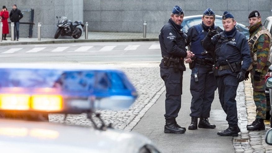 Feb. 2, 2015: Policemen and a security officer stand outside a European Parliament building in Brussels. (AP)