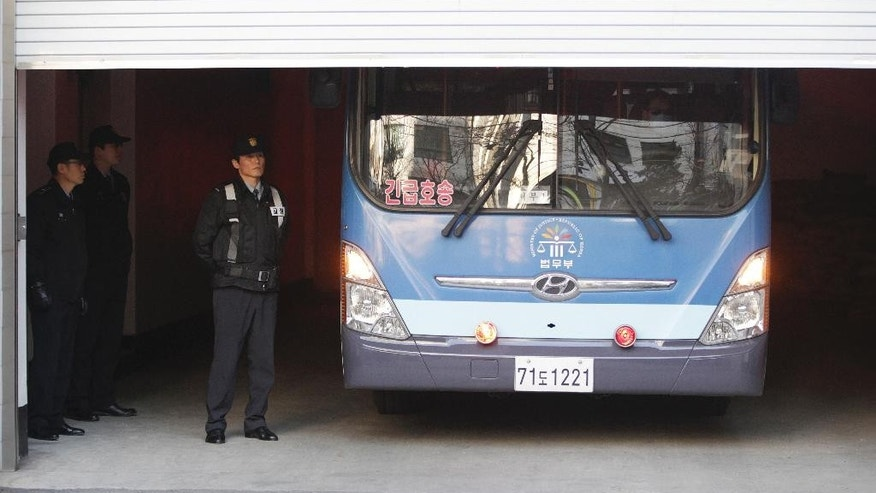 A bus carrying Cho Hyun-ah, former vice president of Korean Air Lines Co., parks shortly after arriving at the Seoul Western District Court building garage in Seoul, South Korea, Monday, Feb. 2, 2015. Cho on trial after an inflight tantrum over a serving of nuts defended her actions as the result of devotion to work in the final day of testimony. (AP Photo/Ahn Young-joon)