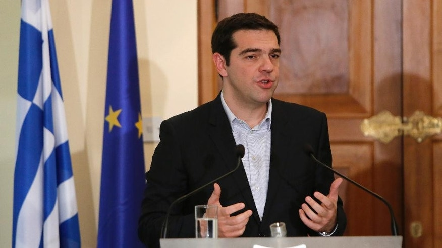 Greek Prime Minister Alexis Tsipras speaks to the media during a press conference after meeting with Cyprus' president Nicos Anastasiades at the Presidential Palace in the capital Nicosia, Monday, Feb. 2, 2015. Tsipras is visiting Cyprus, his first trip abroad as prime minister since his election last month. It's customary for all newly-elected Greek prime ministers to conduct their first trip abroad to Cyprus because of the two countries' deep historic ties. (AP Photo/Petros Karadjias)
