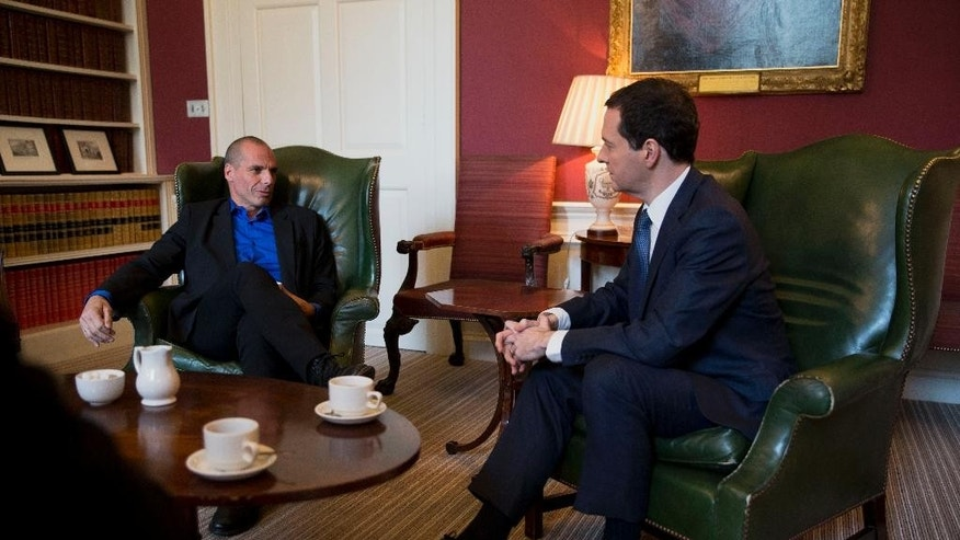 British Finance Minister George Osborne, right, and Greece's new finance minister Yanis Varoufakis speak during their meeting at 11 Downing Street in London, Monday, Feb. 2, 2015.  France's Socialist government offered support Sunday for Greece's efforts to renegotiate debt for its huge bailout plan, amid renewed fears about Europe's economic stability.  The backing was a victory for Varoufakis, striking a more conciliatory tone as he seeks new conditions on debt from creditors who rescued Greece's economy to save the shared euro currency. (AP Photo/Matt Dunham, Pool)