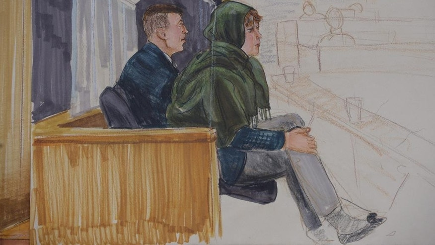 In this courtroom sketch, John Nuttall, left, and Amanda Korody appear in court in Vancouver, British Columbia, Monday. Feb. 2, 2015. Nuttall and Korody have pleaded not guilty to charges of conspiring to commit murder, conspiring to place explosives on behalf of a terrorist group, facilitating terrorist activity and possessing explosives on behalf of a terrorist group. (AP Photo/The Canadian Press, Felicty Don)