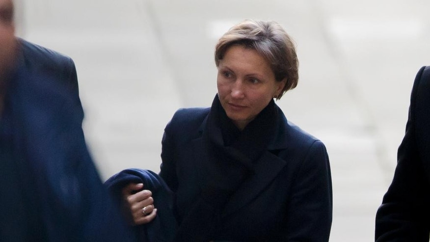 "Marina Litvinenko, the widow of former Russian intelligence officer Alexander Litvinenko, arrives on the day she is due to give evidence at the inquiry into her husband's death at the Royal Courts of Justice in London, Monday, Feb. 2, 2015.  The body of former Russian agent Alexander Litvinenko was so radioactive that his post-mortem was ""one of the most dangerous"" ever undertaken and the isotope that killed him so rare it would not have been discovered by a normal autopsy, a pathologist said Wednesday.  (AP Photo/Matt Dunham)"