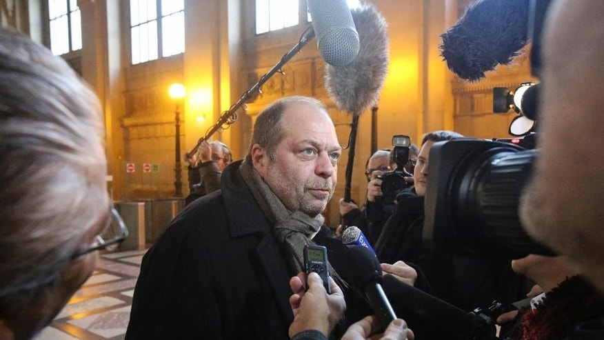 Eric Dupond-Moretti, lawyer of Karim Debaa, addresses reporters at Paris Court House, Tuesday Feb. 3, 2015, at the start of the trial of eight men accused of one of the world's biggest jewel heists in Paris. The men are accused of stealing more than 200 luxury watches and more than 600 pieces of jewelry from a Harry Winston boutique in two audacious operations. Many of the jewels have never been found. (AP Photo/Remy de la Mauviniere)