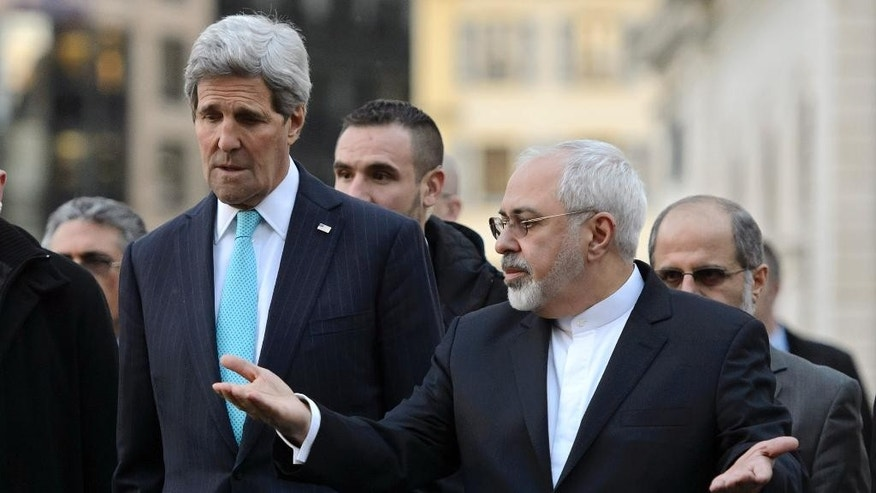 FILE - In this Jan. 14, 2015 file picture US Secretary of State John Kerry, left, listens to  Iranian Foreign Minister Mohammad Javad Zarif, as they walk in the city of Geneva, Switzerland, during a bilateral meeting ahead  of nuclear discussions. With time for negotiations running short, the U.S and Iran are discussing a compromise that would let Iran keep much of its uranium-enriching technology but reduce its potential to make nuclear weapons, two diplomats tell The Associated Press.  (AP Photo/Keystone,Martial Trezzini, File)