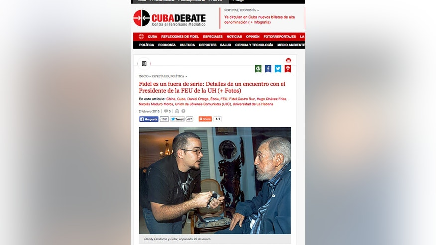 A screenshot of Cuba's website Cubadebate shows a photo of Fidel Castro with the head of the main Cuban student union Randy Perdomo Garcia  in Havana, Cuba, Tuesday Feb. 3, 2015. Cuba has published the first photos of Fidel Castro in five months, showing the 88-year-old former leader engaged in conversation with Perdomo Garcia. A first-person account by the student leader  says the meeting took place on Jan. 23. The photos published around midnight on Monday are the first images of the revolutionary leader since a set of photos came out in August showing him talking with Venezuelan President Nicolas Maduro.(AP Photo)