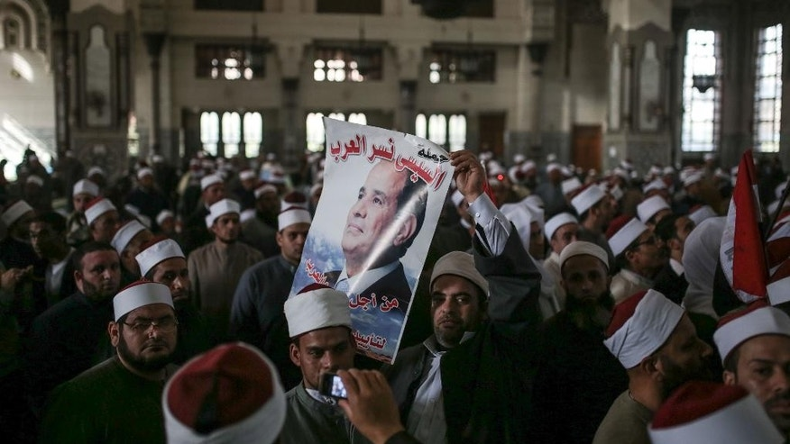 Egyptian clerics from Al-Azhar institution rally to denounce terrorism and show solidarity with the Egyptian government and security forces at a mosque in central, Cairo, Egypt, Tuesday, Feb. 3, 2015. Egyptian President Abdel Fattah al-Sissi told the nation in a televised address Saturday to prepare for a long fight to defeat Islamic extremists following a wave of attacks on security forces in the Sinai Peninsula. An Islamic State-linked group in Egypt claimed responsibility for a string of bomb and gun attacks last week targeting Egyptian military positions that killed at least 30 security force members. (AP Photo/Mosa'ab Elshamy)