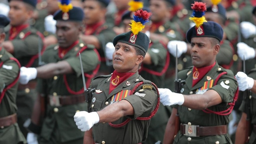 Sri Lankan army soldiers march during Independence Day celebrations in Colombo, Sri Lanka, Wednesday, Feb. 4, 2015. Sri Lanka has failed to heal its deep ethnic divide since the end of the nation's civil war five years ago, the president acknowledged Wednesday in a major speech calling for national reconciliation. (AP Photo/Eranga Jayawardena)
