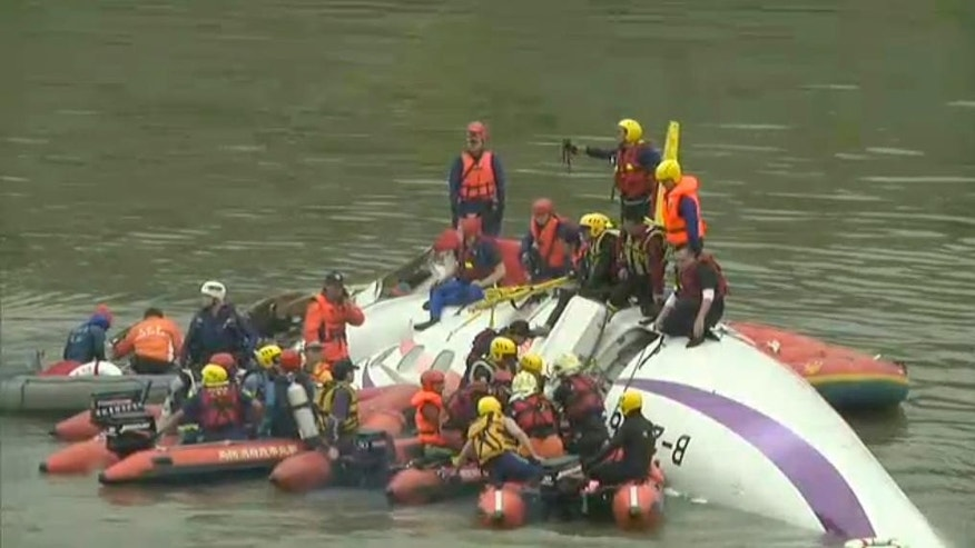 In this image made from Associated Press Television video, a commercial plane lies in river after crashing in Taipei, Taiwan, Wednesday, Feb. 4, 2015. The Taiwanese commercial flight with 53 passengers aboard clipped a bridge shortly after takeoff and crashed into a river in the island's capital of Taipei on Wednesday morning. (AP Photo)