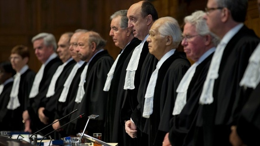 Feb. 3, 2015: Presiding judge Peter Tomka of Slovakia, fourth from right, opens the World Court session in The Hague, Netherlands. (AP Photo/Peter Dejong)