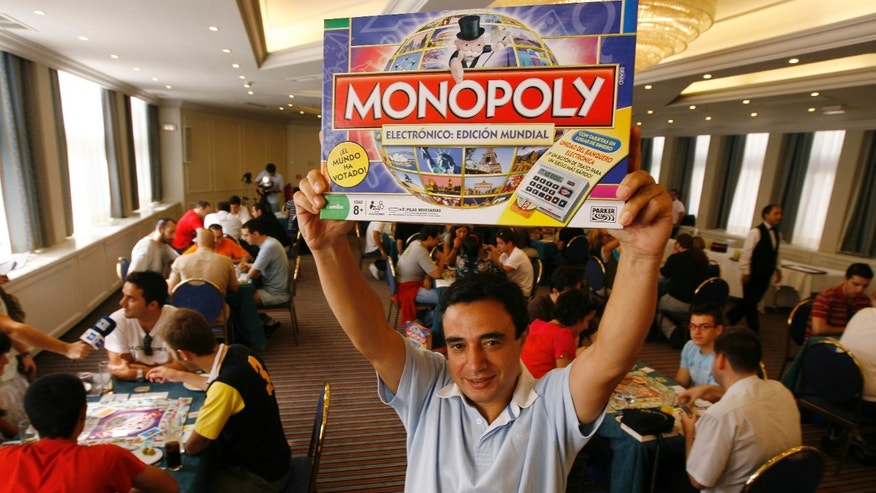 Aug. 27, 2008: Monopoly World Champion Antonio Zafra Fernandez holds up a Monopoly game box at a hotel in Madrid.