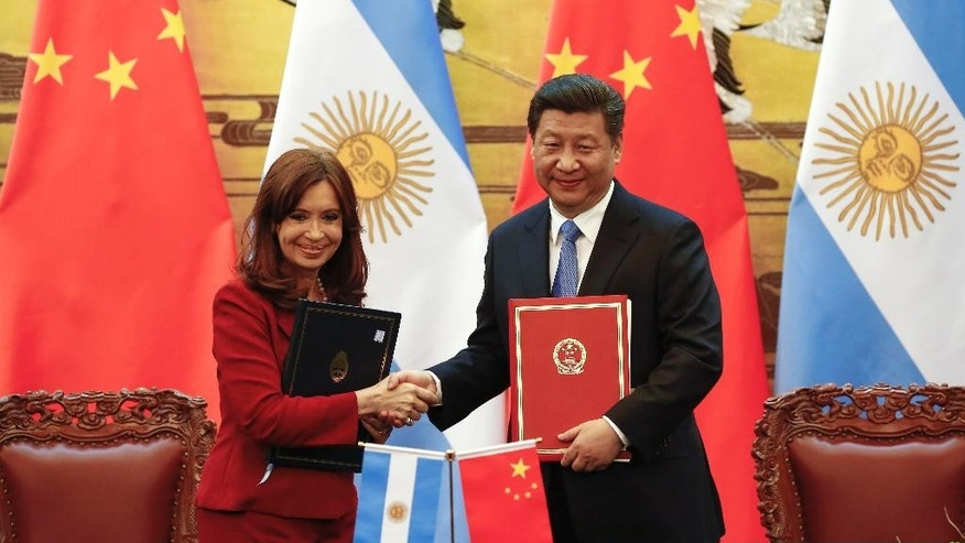 Chinese President Xi Jinping, right, and Argentinian President Cristina Fernandez shake hands after signing documents following their meeting at the Great Hall of the People in Beijing Wednesday, Feb. 4, 2015. (AP Photo/Rolex Dela Pena)