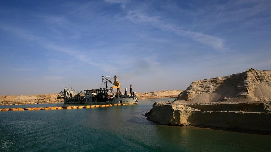 A dredger floats on a new section of the Suez canal during a media tour in Ismailia, Egypt, Wednesday, Feb. 4, 2015. The head of the Suez Canal Authority, Mohab Mameesh, says work is on schedule and that so far, 86 percent of the dry digging and 21 percent of the dredging has been completed, with the new section expected to be completed in August 2015. (AP Photo/Hassan Ammar)