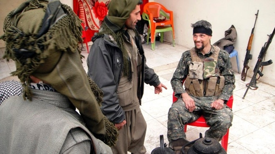 Jan. 29, 2015: In this file photo, Jordan Matson, 28, right, a former U.S. Army soldier from Sturtevant, Wis., takes a break with other fighters from the main Kurdish militia, the People's Protection Units, or YPG, in Sinjar, Iraq.