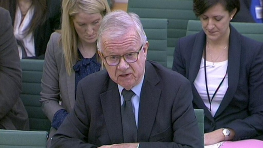 "In this screen shot, Iraq Inquiry chairman Sir John Chilcot gives evidence to the Foreign Affairs Committee in the House of Commons, London, Wednesday Feb. 4, 2015. The man leading an inquiry into Britain's role in the Iraq war says he can't estimate when his long-delayed report might be published. John Chilcot was pressed by a committee of lawmakers about the publication date for his report. He began his inquiry in 2009 and heard from the final witness in 2011. Last month Chilcot conceded that his report would not be published before Britain's national election in May and on Wednesday he said ""it's impossible to say"" when it would be ready and he didn't want to raise false hopes. (AP Photo/PA) UNITED KINGDOM OUT  NO SALES  NO ARCHIVE"