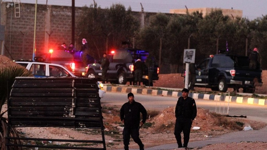Jordanian security stand guard outside Swaqa prison, after the executions of Sajida al-Rishawi and Ziad al-Karbouly, two Iraqis linked to al-Qaida, about 50 miles (80 kilometers) south of the Jordan's capital, Amman, Wednesday, Feb. 4, 2015. Jordan executed two al-Qaida prisoners before dawn Wednesday, just hours after an online video purported to show Islamic State group militants burning a captured Jordanian pilot to death in a cage. (AP Photo/Raad Adayleh)