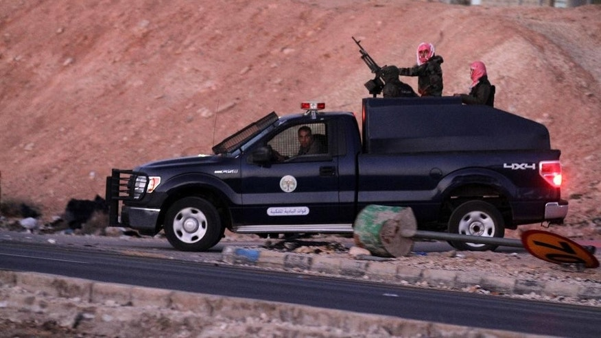 Jordanian security forces leave Swaqa prison, after the executions of Sajida al-Rishawi and Ziad al-Karbouly, two Iraqis linked to al-Qaida, about 50 miles (80 kilometers) south of the Jordan's capital, Amman, Wednesday, Feb. 4, 2015. Jordan executed two al-Qaida prisoners before dawn Wednesday, just hours after an online video purported to show Islamic State group militants burning a captured Jordanian pilot to death in a cage. (AP Photo/Raad Adayleh)